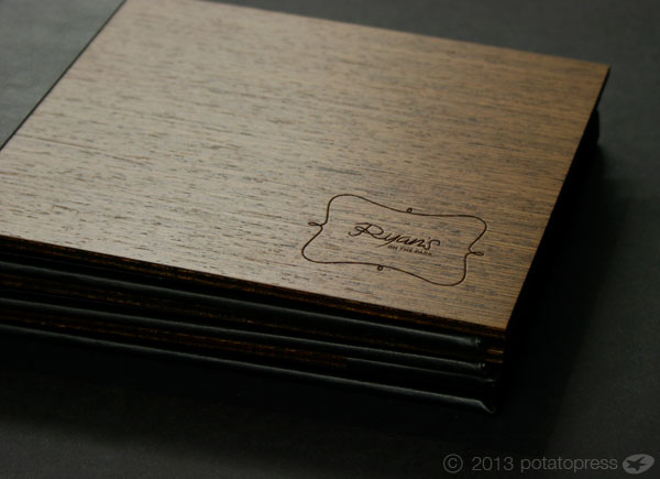 Ryans-Bar-Laser-Cut-and-and-leather-wrapped-menu-Potato-Press