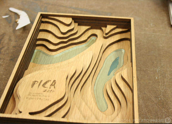 pica-awards-in-closeup-in-progress-handmoving-wood-pica-potatopress-australia-brisbane-goldcoast-international-australiawide-custom-trophy-joinery-timber-acrylic-custom